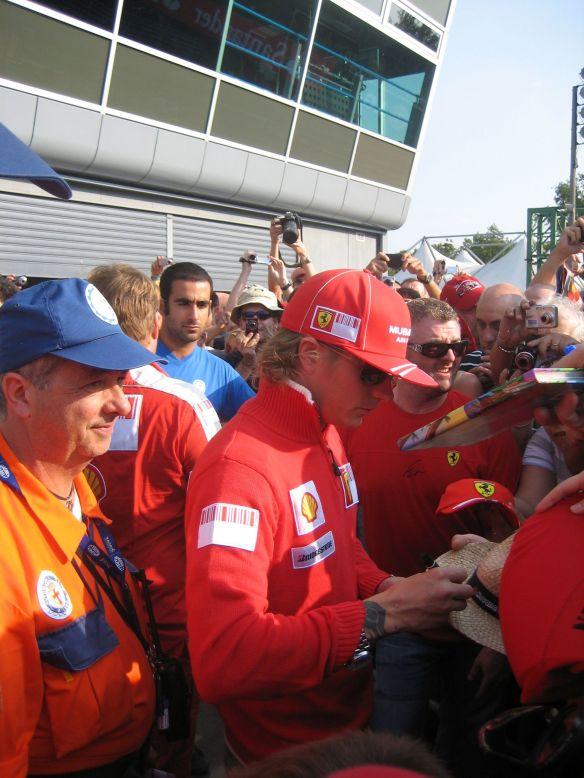 Ferrari driver Kimi Raikkonen signs autographs at Monza, 2009.