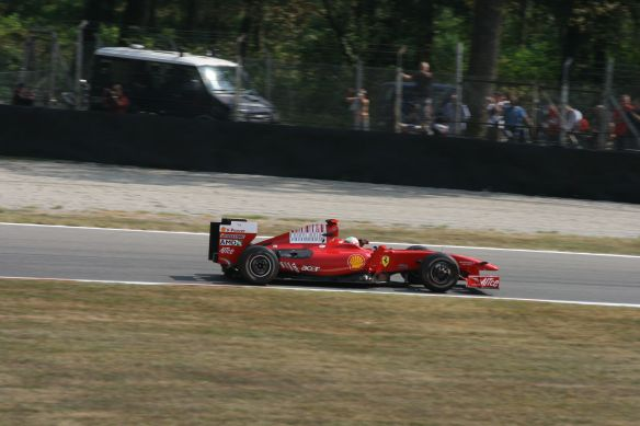 Ferrari driver Giancarlo Fisichella races around the Monza track.