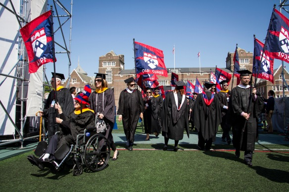 Harry Gross, W'44, leading the alumni flags onto Franklin Field for the University of Pennsylvania's Commencement, May 2014. Photo copyright: University of Pennsylvania.