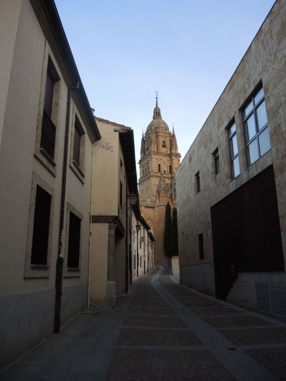 An empty street leading to the cathedral.