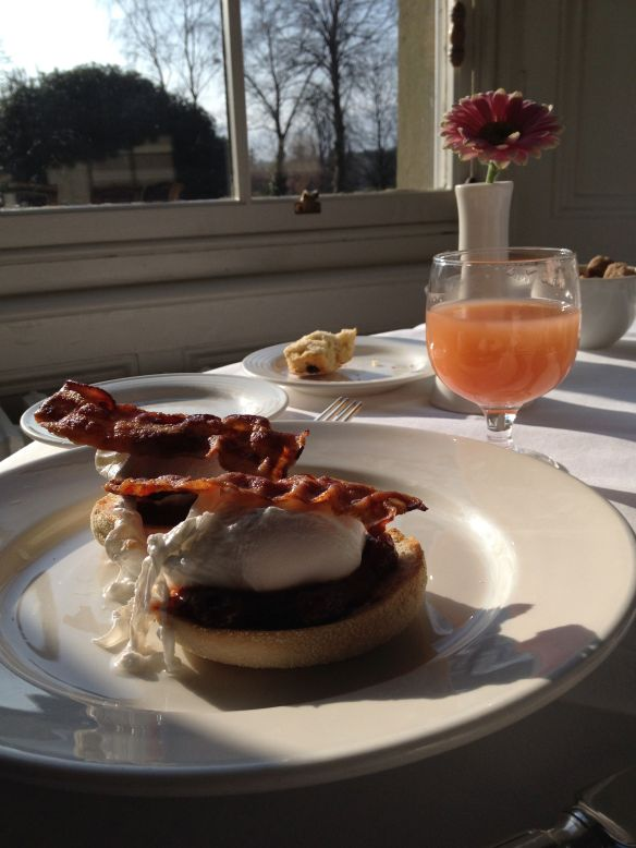 Poached eggs, English muffins, crisp bacon, grapefruit juice and a sunny view.