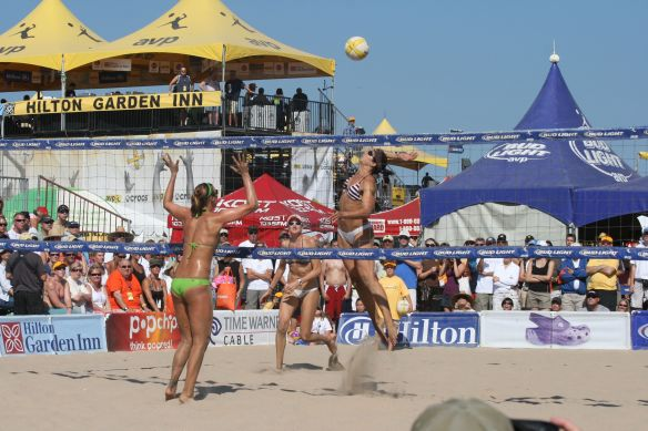 AVP Beach Volleyball has ads alongside playing courts.