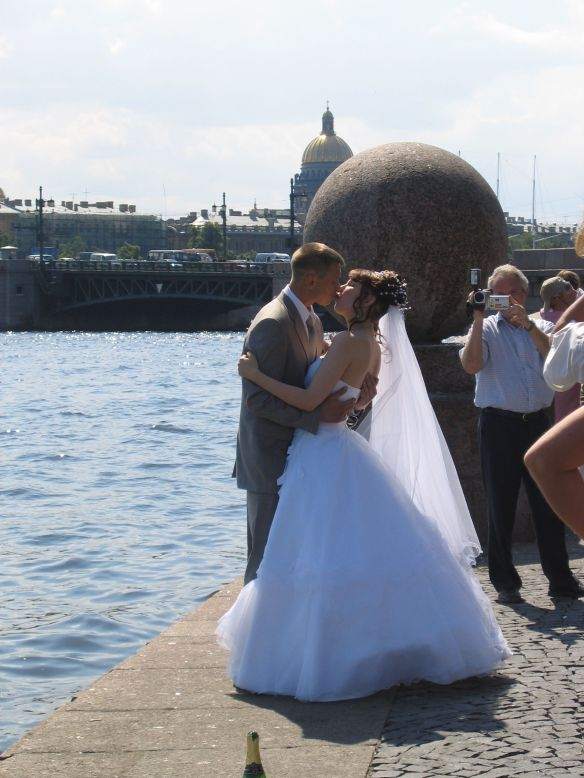 Kissing along the water in St. Petersburg, Russia.
