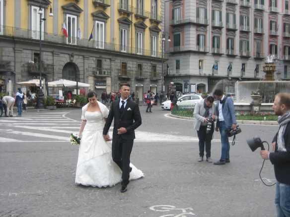 Bride and groom in Naples with their camera and video crew.