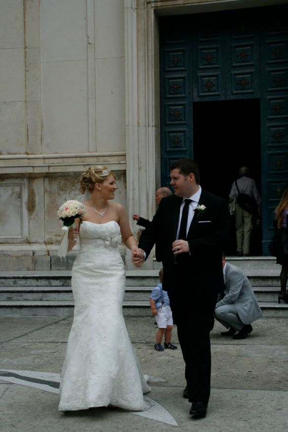 Happy couple in Positano leaving the church.
