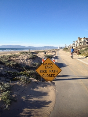 Portions of the bike path were closed due to the sand blown on the path.