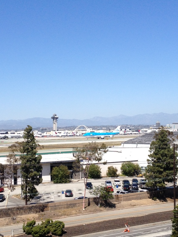 A KLM 747 taxis on the runway at LAX.