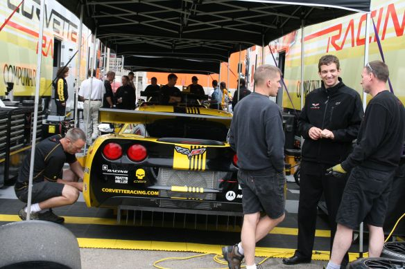 Corvette Racing's Oliver Gavin and crew members by the car in 2008