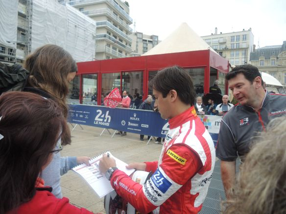 Nelson signs autographs for the fans at Le Mans.