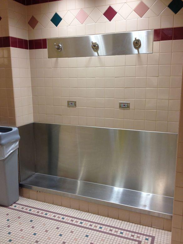 COS Colorado Springs airport bathroom shelf and coat rack