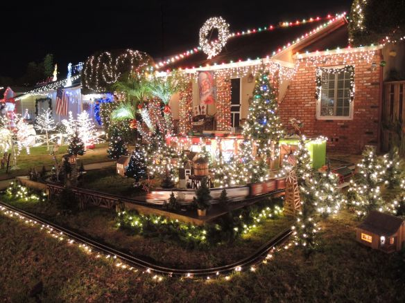 Model trains and Christmas lights on a home on El Segundo's Candy Cane Lane