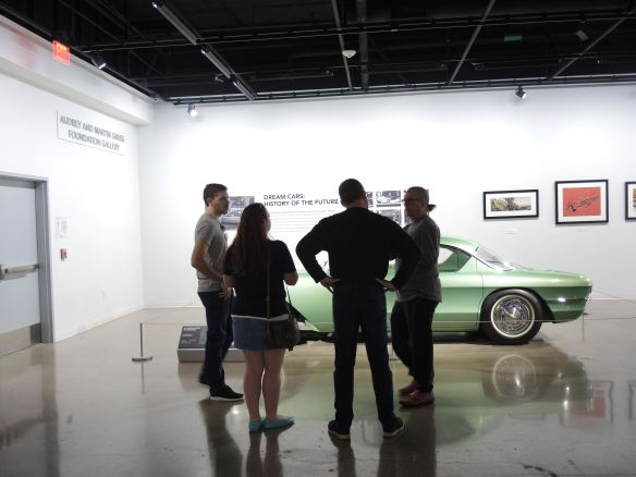 LA Formula 1 Fans at the Petersen Automotive Museum talk by a 1955 Chevrolet Biscayne XP-37