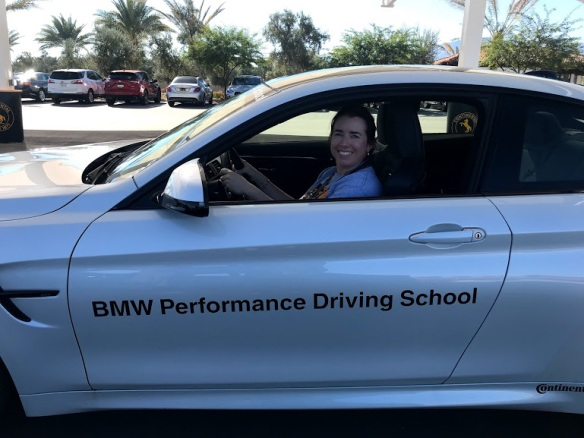 Kiera Reilly behind wheel of BMW m4 at BMW Performance Driving School #drive2learn conference with A Girl's Guide to Cars