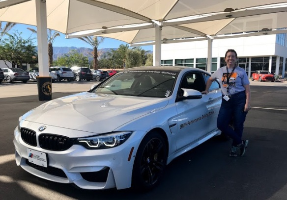 BMW Performance Driving School driving a BMW M4 on the track with Kiera Reilly for A Girl's Guide to Cars #Drive2Learn conference